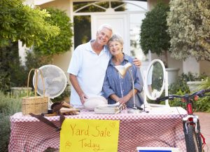 42248295 - senior couple holding yard sale