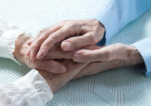 42837142 - old people couple holding hands closeup. happy family