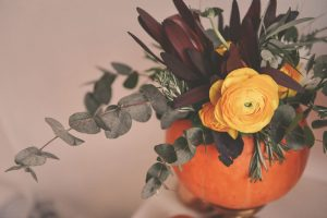 This fun DIY project makes new use of a pumpkin, a great idea for seniors in assisted living facilities who want to brighten up their space for the holidays.
